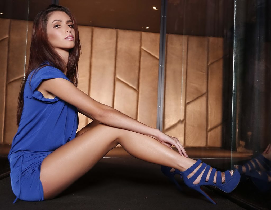 Very Sexy Legs Of Model In Blue Dress and High Heels